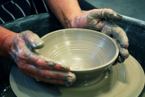 Students at our evening class enjoy using the pottery wheel